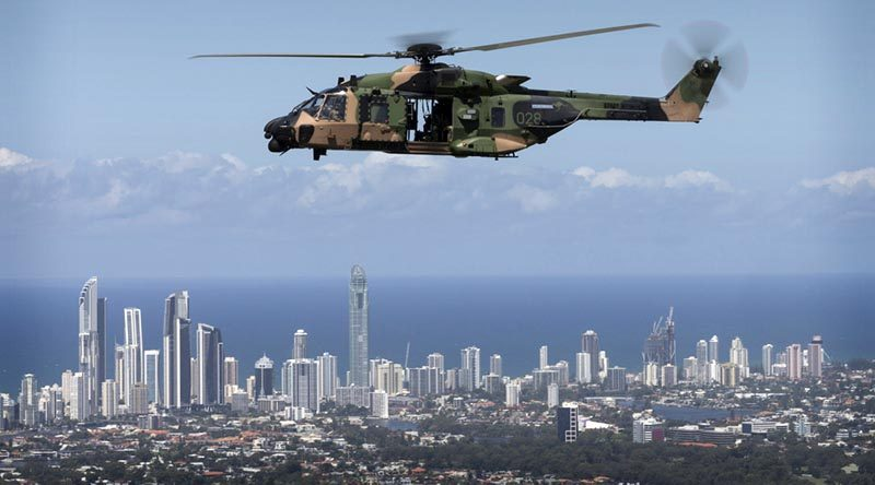 An Australian Army MRH-90 helicopter takes Queensland Police Service Special Emergency Response Team members over the Gold Coast during familiarisation training for the 2018 Commonwealth Games. Photo by Sergeant W Guthrie.