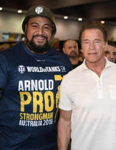 Australia's strongest man Eddie Williams with Arnold Schwarzenegger at the 'World of Tanks PC Tank Pull' at the Arnold Pro Strongman Australia in Melbourne. Photo by Nathan Hopkins.