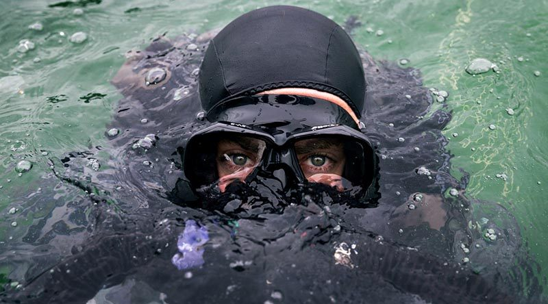 Royal Australian Navy clearance diver Able Seaman Humphrey Macleod submerges during a training activity in support of Queensland Police for the 2018 Gold Coast Commonwealth Games. Photo by Corporal Kyle Genner.