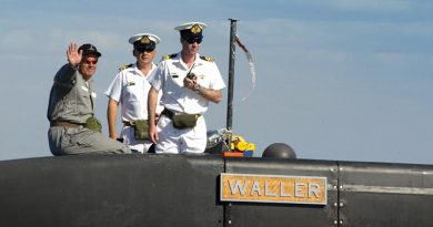 FILE PHOTO: Then Senator David Johnston (left) on board the Australian Submarine Corporation-built Collins-class submarine HMAS Waller. Photo by Petty Officer Steve Coates.