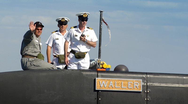 FILE PHOTO: Then Senator David Johnston (left) on board the Australian Submarine Corporation-built Collins-class submarine HMAS Waller. Photo by Petty Officer Steve Coates.