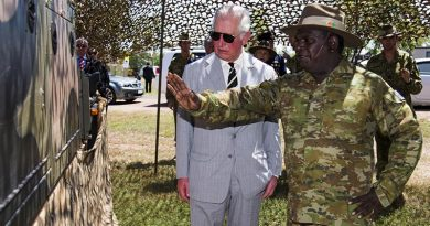 HRH Prince Charles listens to Private Renford Manmurulu explain the use and capability of the regional force surveillance vehicle during the Prince's visit to Larrakeyah. Photo by Leading Seaman James Whittle.