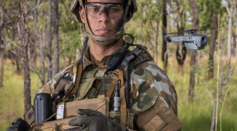 Australian Army Trooper Sam Menzies deploys a PD-100 Black Hornet nano unmanned aircraft during an exercise at Shoalwater Bay. Photo by Nunu Campos.