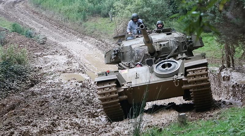 A ex-Australian Army Centurion tank bush bashing at South Gippsland Tank Adventures, to promote the tank's launch inside the global PC game World of Tanks. Photo by Brian Hartigan.