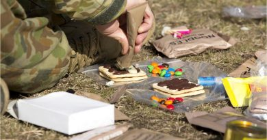 An Australian Army staff cadet from Royal Military College, Duntroon, combines some ingredients during a lecture on ration packs at the Majura training area. Photo by Corporal Bill Solomou.
