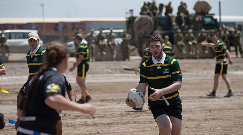Australian and New Zealand members of Task Group Taji-6 compete in a game of modified rugby league to help raise money for charity on Anzac Day in Iraq.