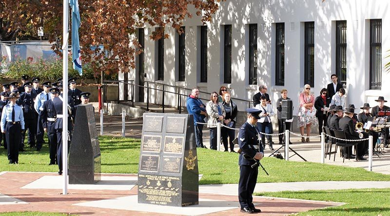 The Ensign Orderly from No 6 Wing, AAFC in position in front of the contingent from No 462 Squadron, RAAF, at a Bomber Command Commemoration Service at Torrens Parade Ground in Adelaide. Photo by Flying Officer (AAFC) Paul Rosenzweig.