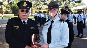 LCDT Caitlyn Edmunds (601 Squadron) receives the trophy for the F-88 (WTSS) Champion Shot.