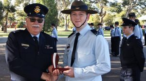 """LCDT Jacob Lavery (622 Squadron) receives the trophy for the Wing .22"""" LR Champion Shot."""