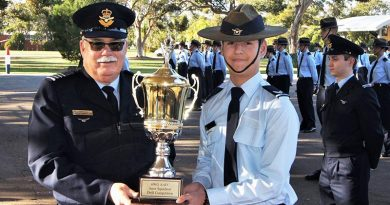 Cadet Corporal Nicholas Sibly accepts the Wing Inter-Squadron Drill Competition trophy on behalf of No 601 Squadron. Photo by Flying Officer (AAFC) Paul Rosenzweig
