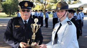 Cadet Flight Sergeant Casey Dibben accepts the Wing Freestyle Drill Competition trophy on behalf of No 608 (Town of Gawler) Squadron.
