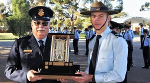 Cadet Sergeant Ben Whiting from No 609 Squadron (Warradale Barracks) receives the Catalina Cup Trophy from the Officer Commanding No 6 Wing, Wing Commander (AAFC) Peter Gill.