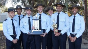 The 609 Squadron winning team with the Catalina Cup and F-88 (WTSS) Team Shooting Competition trophies (left to right): CDT Declen Love, LCDT Jesvi John, CCPL Jeremy Swain, CSGT Ben Whiting, CDT Lucy Beck, LCDT Fabian D'Mello and CCPL Joshua Dsa.