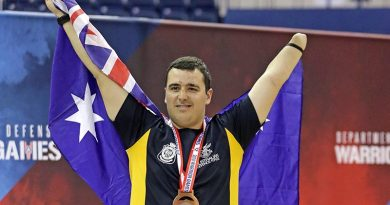 Royal Australian Air Force Pilot Officer Nathan Parker celebrates his bronze-medal performance in indoor rowing at the Warrior Games 2018 at the United States Air Force Academy, Colorado Springs in the USA. Photo by Leading Seaman Jason Tufrey.
