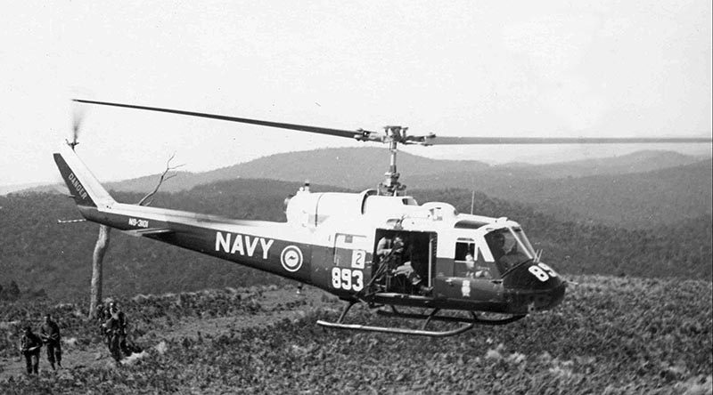 RAN UH-1 Iroquois helicopter operating in Vietnam. The ubiquitous Bell UH-1 Iroquois helicopter is still arguably the most instantly recognisable symbol of the Vietnam War. Images of the 'helicopter war' feature prominently in books, films and documentaries. Not so widely known is the role that was played by personnel of the RAN's Fleet Air Arm (FAA), in a war that was heavily dependent on tactical air movement of combat troops, supplies and equipment in what were eventually called air-mobile operations. Between 1967 and 1971 the Royal Australian Navy Helicopter Flight Vietnam (RANHFV), was fully integrated with the US Army 135th Assault Helicopter Company (AHC) flying Iroquois helicopters in both the utility and gun-ship configurations. As a result of this unique relationship between the RAN and the US Army, the unit was officially designated 'EMU', for Experimental Military Unit. This was fitting, given that the EMU is a native Australian bird, yet amusing at the same time because of the Emu's inability to fly. The unit later designed its own unique badge and adopted the unofficial motto 'get the bloody job done'. In keeping with Australian Naval tradition many of the aviators also grew beards to distinguish themselves as sailors in a predominantly army environment. The 135th AHC was initially based at Vung Tau and comprised two troop lift platoons, each with eleven UH-1Ds, a gun-ship platoon with eight UH-1Cs, a maintenance platoon with a single UH-1D and a headquarters platoon. Six of the gun-ships were equipped with mini guns, rockets and machine guns. The remaining two were fitted with the XM-5 40mm grenade-launcher system, rockets and machine guns. The role of 135th AHC was to provide tactical air movement of combat troops, supplies and equipment in air-mobile operations. This included augmentation of army medical services, search and rescue and the provision of a command and control aircraft capability.