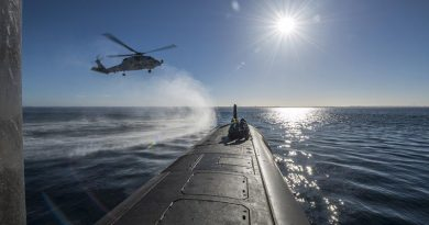 HMAS Ballarat's MH-60R Seahawk conducts a forward passenger transfer with HMAS Rankin in Western Australia, before the submarine departs for RIMPAC18. Photo by Able Seaman Grahame Kelaher.