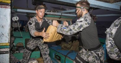 HMAS Warramunga boarding party members Able Seaman Corey Bartlett and Able Seaman Jacob Dun relocate parcels of seized narcotics. Photo by Leading Seaman Tom Gibson.