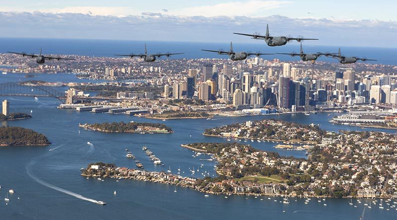 A formation of C-130J Hercules fly over Sydney Harbour to mark the 75th Anniversary of No. 37 Squadron. Photo by Corporal David Gibbs.