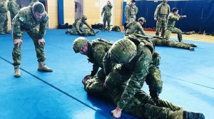 Members of 7th Battalion, The Royal Australian Regiment, 1st Armoured Regiment, 1st Combat Service Support Team and 16 Air Land Regiment undertake Army Combatives Program training at RAAF Base Edinburgh.