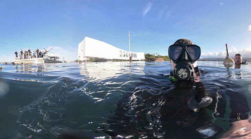 Royal Australian Navy sailor Able Seaman Clearance Diver Benjamin Johnson grabs a selfie before diving on the USS Arizona Memorial site in Pearl Harbor, Hawaii, during RIMPAC 2018. Photo by Able Seaman Benjamin Johnson.