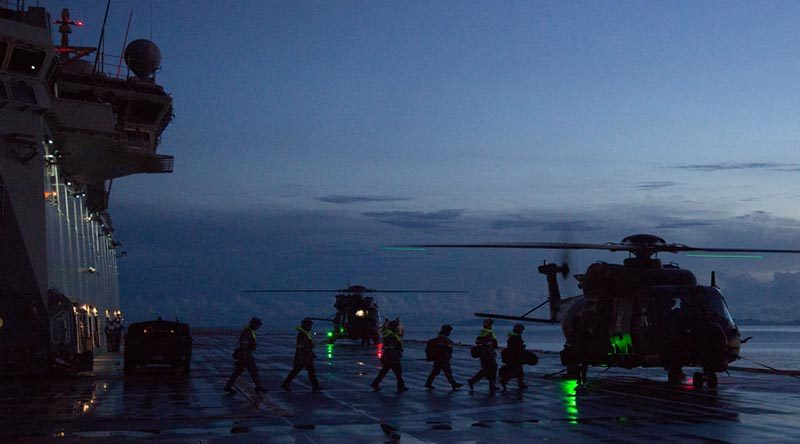 Medical teams and Solomon Island Police Force personnel board waiting MRH-90 helicopters on HMAS Adelaide to support a medical evacuation from an island near Honiara, Solomon Islands. Photo by Chief Petty Officer Damian Pawlenko.