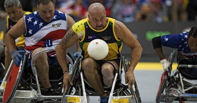 Australian Invictus team member Peter Arbuckle contests the ball during the wheelchair rugby bronze-medal play-off match against the United Stags during the Invictus Games in Toronto, Canada. Photo by Leading Seaman Jason Tufrey.