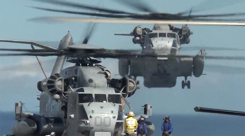Two US Marine Corps CH-53E Super Stallions operate from HMAS Adelaide during the final amphibious assault of RIMPAC 2018. US DoD video screen grab.