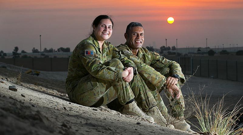 Australian Army soldiers Private Nikita Rounds and her father Sergeant Joseph Rounds catch up in the Middle East while concurrently deployed on operations in the region. Photo by Petty Officer Andrew Dakin.