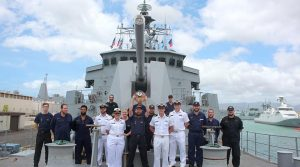 HMNZS Te Mana operations and weapons teams with the Naval Surface Fire Support Rodeo trophy.
