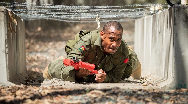 A soldier from the Republic of Fiji Military Forces crawls under an obstacle during Exercise Hydra at Enoggera Barracks in Brisbane. Photo by Corporal Nunu Campos.