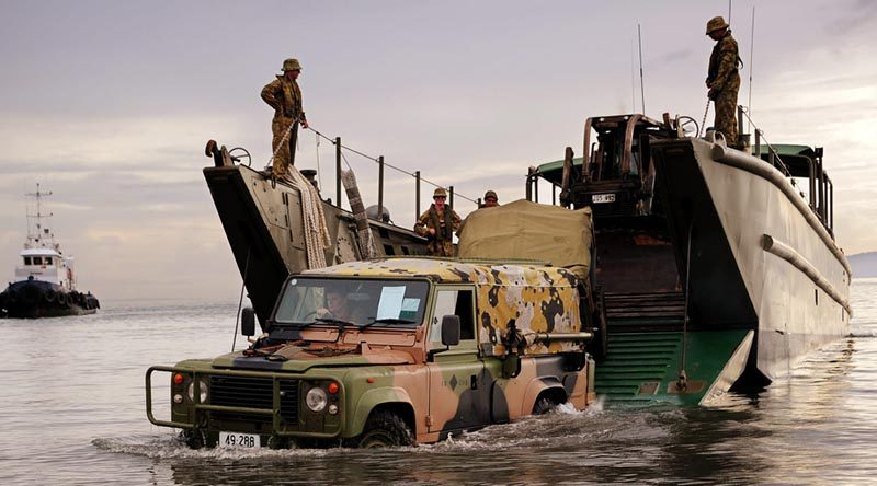 An Australian Army Land Rover disembarks a landing craft onto a beach in Ormoc, Philippines, during Operation Philippines Assist. Photo by Corporal Jake Sims.
