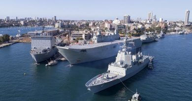 NUSHIP Brisbane arrives at Fleet Base East for the first time, joining (left to right) HMA Ships Choules, Adelaide, Success, Warramunga and ex-HMAS Darwin. Photo by Warrant Officer Shane Cameron.
