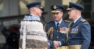 Chief of Defence Force Air Marshal Kevin Short, right, shakes hands with new Chief of Air Force Air Vice-Marshal Andrew Clark, with outgoing Chief of Air Force Air Vice-Marshal Tony Davies centre, at the change of command ceremony in Auckland today. NZDF photo.