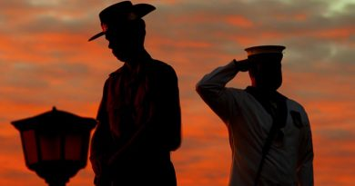 An Army Catafalque Party member rests on arms reversed as a Navy bugler salutes during an Anzac Day dawn service at Monument Hill, Fremantle, Western Australia. ADF photo.
