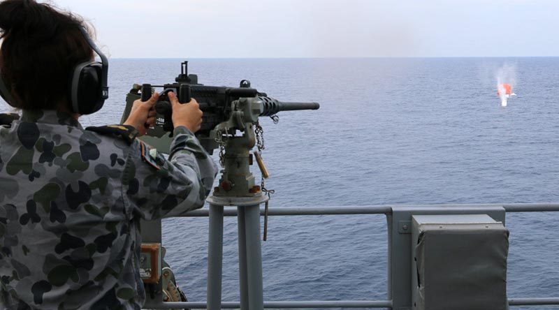Able Seaman Stephanie Pannell engages a 'killer tomato' with a Browning M2 12.7mm machine gun on HMAS Warramunga during Exercise Bersama Lima 2016. Photo by Chief Petty Officer Martin Anderson.