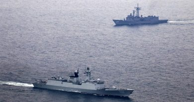 People's Liberation Army - Navy ship Xianning and HMAS Melbourne (background) during a passage exercise. ADF photo.