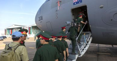 Personnel from the Vietnamese People's Army take the opportunity to look at a Royal Australian Air Force C-17A Globemaster at Tan Son Nhat International Airport. Photo by Corporal David Gibbs.