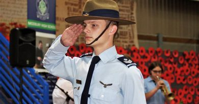 Catafalque Party Commander Cadet Flight Sergeant Tomasz Kocimski salutes during the Last Post. CFSGT Kocimski wears the General Flying Proficiency Badge – aged 17, he has qualified as a solo pilot in both powered aircraft and gliders. Photo by Flying Officer (AAFC) Paul Rosenzweig.