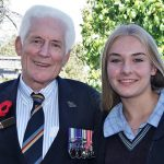 Don Cameron at Modbury High School with his grand-daughter Megan, in the school's Anzac Garden which was established in 2015 to commemorate the Centenary of Anzac. Photo by Flying Officer (AAFC) Paul Rosenzweig.