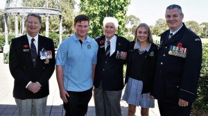 Don Cameron (centre) at Modbury High School with his grandchildren Scott and Megan, with Brian Selby (SA/NT Branch President, NMBVAA) and Flying Officer (AAFC) Paul Rosenzweig, Headquarters 6 Wing, AAFC. They are pictured in the school's Anzac Garden, which was established in 2015 to commemorate the Centenary of Anzac. Photo by Cadet Corporal Levi Schubert.