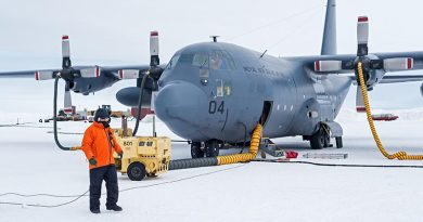 Sergeant David Wood in front of an C-130H(NZ) Hercules at Pegasus Airfield. The first Air Force C-130 Hercules ice flight of the season to Antarctica arrived at Pegasus Airfield, delivering cargo and returning to New Zealand with freight and passengers. NZDF photo.