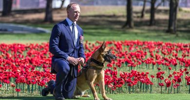Corporal Mark Donaldson VC and MWD Odin prepare to accept the posthumously awarded PDSA Dickin Medal on behalf of Special Air Service Regiment military working dog Kuga at the Australian War Memorial, Canberra. Photo by WO2 R Nyffenegger.