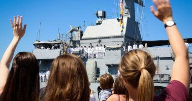 Family and friends wave goodbye to their loved ones on HMAS Ballarat as the ship sails from Fleet Base West, WA, to commence a nine-month operational deployment to the Middle East. Photo by Leading Seaman Kylie Jagiello.