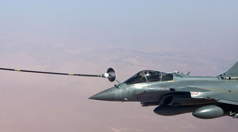 A Royal Australian Air Force KC-30A Multi Role Tanker Transport aircraft refuels a French Air Force Dassault Rafale fighter on operations in the Middle East. Photo by Sergeant Mark Doran.