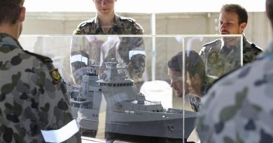 Sailors from the Royal Australian Navy Construction Branch inspect a model of an Arafura-class offshore patrol vessel at Osborne Naval Shipyard in Adelaide. Photo by Lieutenant Ryan Zerbe.