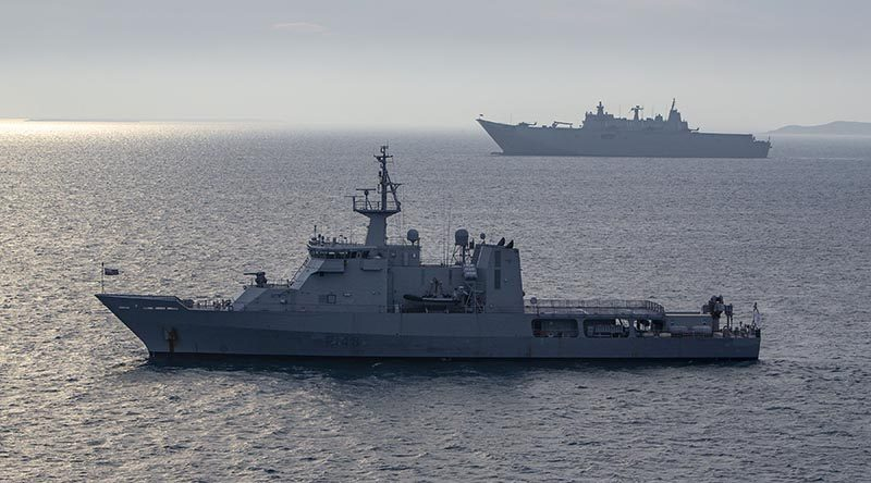 Royal New Zealand Navy offshore patrol vessel HMNZS Otago and Royal Australian Navy amphibious ship HMAS Adelaide at anchor off Port Moresby as part of international support to APEC 2018. ADF photo.