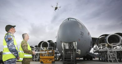 Australian Army Sergeant Andrew Whitelaw, from 16 Air Land Regiment and Corporal Kelvin Green, Aircraft Surface Finisher at Royal Australian Air Force No.36 Squadron, launch a drone to inspect the condition of paint on the upper surfaces of a C-17A Globemaster at RAAF Base Amberley. Photo by Corporal Kylie Gibson.