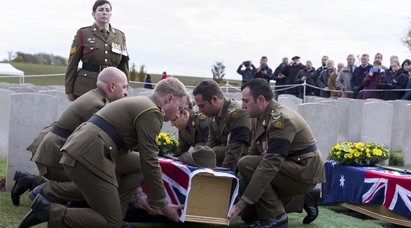 Australian Army pallbearers lower the coffin of a recently identified Australian soldier to his final resting place, at Queant Road Cemetery, France, more than 100 years after he was killed in action on the Western Front. Photo by Leading Seaman Nadav Harel.
