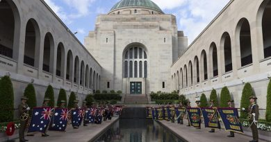 Queen's and Regimental Colours of the Royal Australian Regiment displayed at the Pool of Remembrance following the RAR's 70th-anniversary paradeat the Australian War Memorial. Photo by Sergeant Ray Vance.