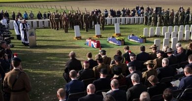 The caskets of unknown First World War Australian and British soldiers lie next to their headstones, during a burial ceremony at Tyne Cot Cemetery, Belgium. Photo by Corporal Jake Sims.